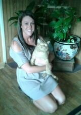 Team member Jacoby with her pet cat