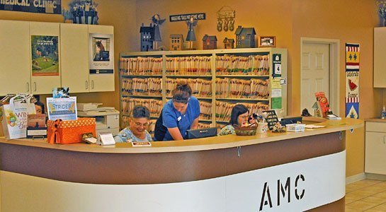 Three team members working hard behind the front desk and reception area