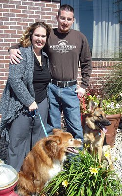 Team members Missy and Tim with their pet dog